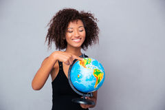 Afro american woman holding globe Royalty Free Stock Image