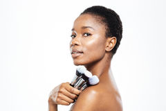 Afro american woman holding makeup brushes Stock Photo