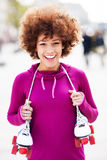 Afro-American woman holding roller-skates Royalty Free Stock Photo