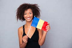 Afro american woman holding Romanian flag Stock Images
