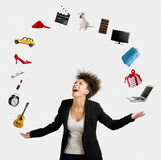 Afro-American woman juggling objects. A Beautiful Afro-American woman juggling multiple objects over the air Royalty Free Stock Photo