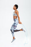 Afro american woman jumping on skipping rope Stock Photo