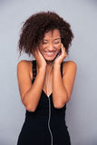 Afro american woman listening music in headphones Royalty Free Stock Image