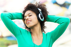 Afro-American woman listening to music Stock Photos