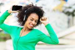 Afro-American woman listening to music Royalty Free Stock Photos