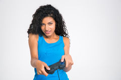 Afro american woman playing in video game with joystick Stock Images