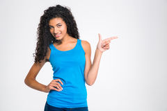 Afro american woman pointing finger away Stock Image