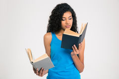 Afro american woman reading book Stock Photo