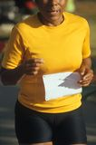 Afro-American woman runner. Senior afroamerican runner finishing foot race Stock Photos