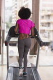 Afro american woman running on a treadmill Royalty Free Stock Photography