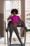 Afro american woman running on a treadmill Stock Image