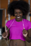 Afro american woman running on a treadmill Stock Photography