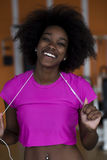 Afro american woman running on a treadmill Stock Photo