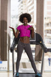 Afro american woman running on a treadmill Royalty Free Stock Photo