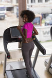 Afro american woman running on a treadmill Royalty Free Stock Photos