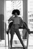 Afro american woman running on a treadmill Royalty Free Stock Image