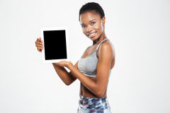 Afro american woman showing blank tablet computer screen. Happy afro american woman showing blank tablet computer screen isolated on a white background Stock Photos