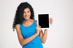 Afro american woman showing blank tablet computer screen. Portrait of a smiling afro american woman showing blank tablet computer screen isolated on a white Stock Photos