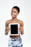 Afro american woman showing blank tablet computer screen Royalty Free Stock Photography