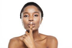Afro american woman showing finger over lips Stock Photos