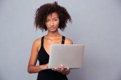 Afro american woman using laptop Stock Photos