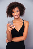 Afro american woman using smartphone Royalty Free Stock Photography
