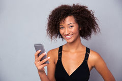 Afro american woman using smartphone Stock Image
