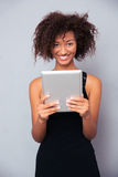 Afro american woman using tablet computer Royalty Free Stock Images