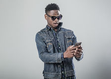 Afro american young man talking on the phone. Stock Images