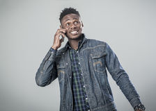 Afro american young man talking on the phone. Royalty Free Stock Photos