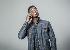 Afro american young man talking on the phone. Stock Photography