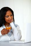 Afro-american young woman drinking orange juice Stock Photos