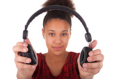 Afro-American young woman with headphone Royalty Free Stock Photos