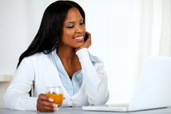 Afro-american young woman looking to laptop screen Royalty Free Stock Image