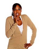 Afro-american young woman screaming. While looking at you on isolated background Stock Photos
