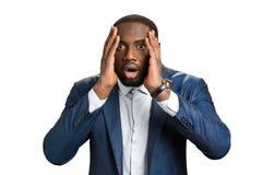 Afro Amerikaanse mens wanhopig in schok stock foto