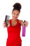 Afro--Amerikan ung kvinna med afro hår Royaltyfri Bild