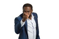 Afro amerykański biznesmen wskazuje palec wskazującego Obrazy Stock