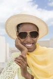 Afro beauty wearing a boater straw hat and a pair of dark sunglasses Stock Photography