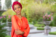 Afro beauty wearing a red headscarf Stock Photo