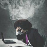 Afro biznesmen czuje migrenę Zdjęcie Royalty Free
