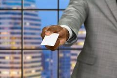 Afro biznesmen daje wizyty karcie Fotografia Stock