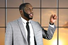 Afro biznesmen wskazuje jego palec Obraz Royalty Free