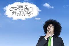Afro biznesmen wyobraża sobie jego sen Obrazy Stock