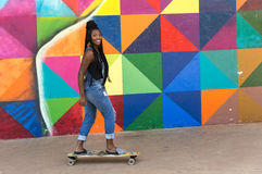 Afro Brazilian girl skateboarding, park Royalty Free Stock Images