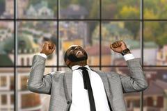 Afro businessman expressing joy. Stock Image