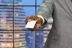 Afro businessman gives visit card. Stock Photography