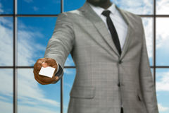 Afro businessman giving visit card. Royalty Free Stock Photos