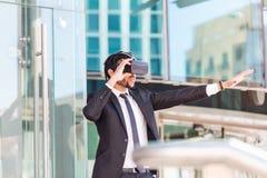 Afro businessman playing virtual reality simulation stock photography