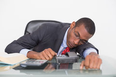 Afro businessman resting at desk over white background Royalty Free Stock Photo